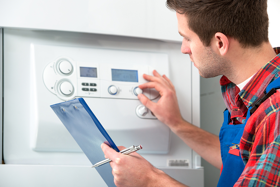 man checks the boiler